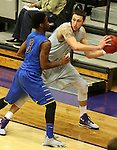 SIOUX FALLS, SD - NOVEMBER 24: Cutler Finneman #50 from the University of Sioux Falls looks for help as Bryant Allen #3 from Dakota State University applies pressure in the first half of their game Monday night at the Stewart Center.  (Photo by Dave Eggen/Inertia)