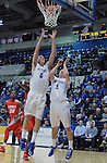 February 4, 2015 - Colorado Springs, Colorado, U.S. -    Air Force forward, Marek Olesinski #0, stretches for a rebound during a Mountain West Conference match-up between the New Mexico Lobos and the Air Force Academy Falcons at Clune Arena, U.S. Air Force Academy, Colorado Springs, Colorado.  Air Force upsets New Mexico 53-49.