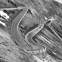 Some of the 48 switchbacks of the western approach of the Passo dello Stelvio, above the town of Prato dello Stelvio, Italy.