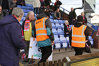 "Stewards confiscate an ""Amar Out"" sign from Kingstonian fans in support of Macclesfield Towns ownership problems during Macclesfield Town vs Kingstonian, Emirates FA Cup Football at the Moss Rose Stadium on 10th November 2019"