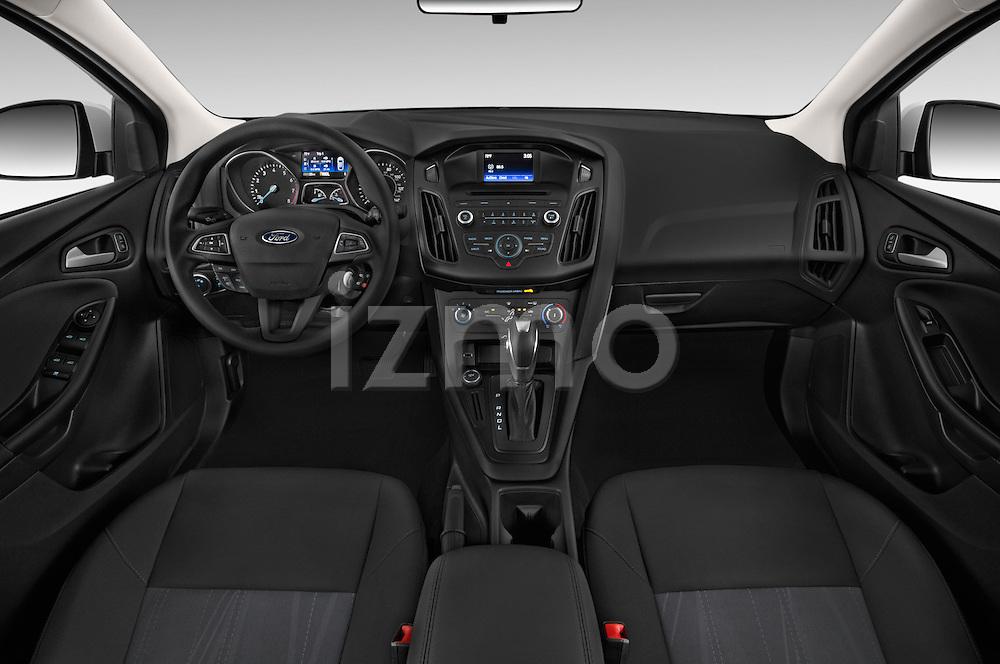 Stock photo of straight dashboard view of a 2015 Ford Focus SE Sedan 4 Door Sedan Dashboard