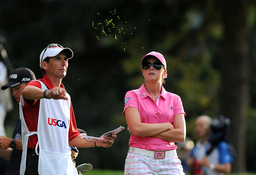 10 JULY 2011:   Paula Creamer, of Pleasonton, California, USA, with caddie Colin Cann, check the wind direction by tossing grass in the airduring the final round of the LPGA U.S. Women's Open at the Broadmoor in Colorado Springs, Colorado.   *****For Editorial Use Only*****