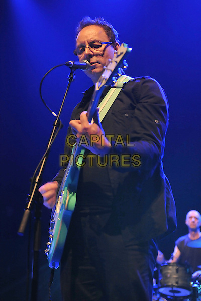 Colin Newman of Wire.Performing live at the Royal Festival Hall, London, England, June 18th 2011..half length music live on stage concert gig microphone singing playing guitar  glasses black jacket .CAP/MAR.© Martin Harris/Capital Pictures.