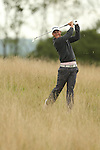 Rhys Enoch plays his second shot on the 4th hole from the deep rough during the second round of the ISPS Handa Wales Open 2013 at the Celtic Manor Resort<br /> <br /> 30.08.13<br /> <br /> ©Steve Pope-Sportingwales
