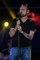 Corey Hart performs at the St-Jean show on the Plains of Abraham in Quebec City during the Fête nationale du Quebec, Thursday June 23, 2016. St-Jean Baptist is Quebec National day and is traditionally celebrated on the Plains of Abraham with a concert and a huge fire.