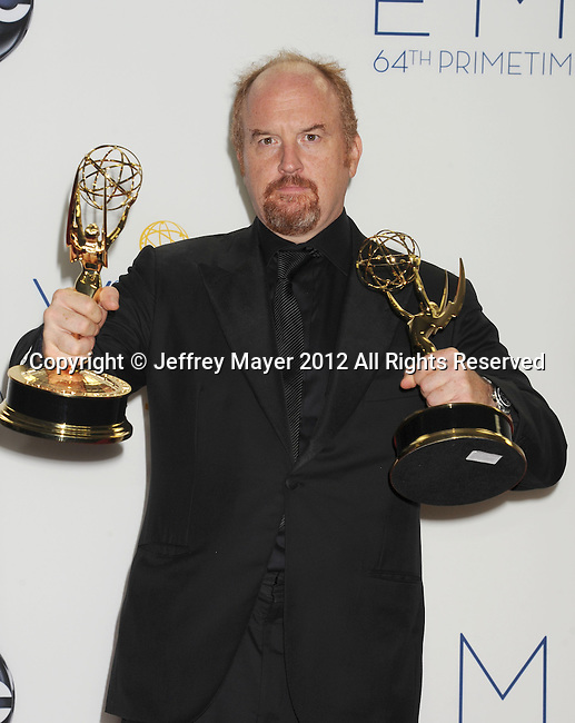 LOS ANGELES, CA - SEPTEMBER 23: Louis C.K.  poses in the press room at the 64th Primetime Emmy Awards held at Nokia Theatre L.A. Live on September 23, 2012 in Los Angeles, California.