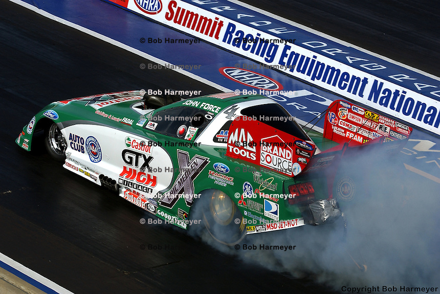 NORWALK, OH - JULY 1: John Force performs a burnout in his Funny Car during the Summit Racing Equipment NHRA Nationals on July 1, 2007, at Summit Motorsports Park near Norwalk, Ohio.