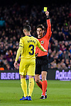 Alvaro Gonzalez of Villarreal (L) gets a yellow card from FIFA Referee Jose Luis Munuera Montero (R) during the La Liga 2018-19 match between FC Barcelona and Villarreal at Camp Nou on 02 December 2018 in Barcelona, Spain. Photo by Vicens Gimenez / Power Sport Images