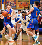 Roxana guard Gavin Huffman (left) passes to teammate Drew Beckman (right) as Alton Marquette  guard Cortez Harris defends.  Alton Marquette played Roxana in the Class 2A Roxana boys basketball regional final at Roxana High School in Roxana, Illinois on Friday February 28, 2020. <br /> Tim Vizer/Special to STLhighschoolsports.com