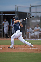 AZL Padres 2 catcher Stephen McGee (34) follows through on his swing in a rehab appearance during an Arizona League game against the AZL Padres 1 at Peoria Sports Complex on July 14, 2018 in Peoria, Arizona. The AZL Padres 1 defeated the AZL Padres 2 4-0. (Zachary Lucy/Four Seam Images)