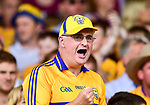 A Clare fan urges on his team during their All-Ireland semi-final replay against Galway at Semple Stadium, Thurles. Photograph by John Kelly.
