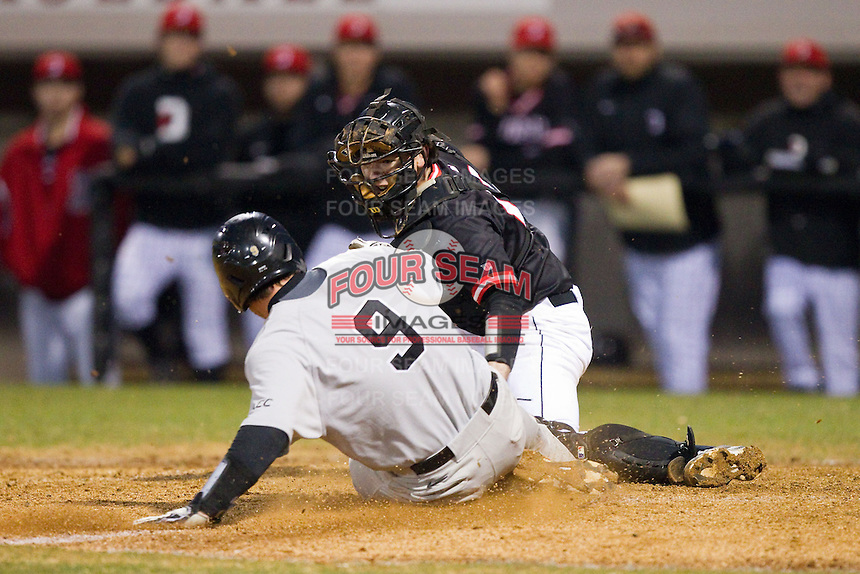 Davidson Wildcats catcher Chris Dyer (19) tags out Ben Breazeale (9) of the Wake Forest Demon Deacons as he tries to score a run at Wilson Field on March 19, 2014 in Davidson, North Carolina.  The Wildcats defeated the Demon Deacons 7-6.  (Brian Westerholt/Four Seam Images)