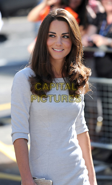 The Duke and Duchess of Cambridge's .visit to the Royal Marsden Hospital, Sutton, Surrey, England .Thursday 29th September 2011.Prince William Kate Catherine Middleton half length royals royalty white dress grey gray.CAP/CAS.©Bob Cass/Capital Pictures.