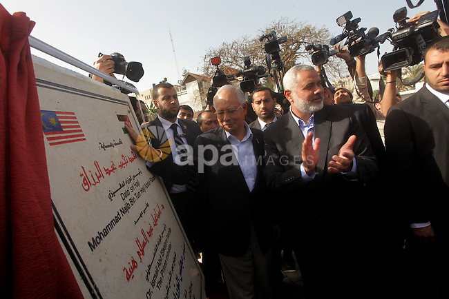 Palestinian Prime Minister Ismail Haniyeh, and Malaysian Prime Minister Najib Razak, look a cornerstone of the construction of a Interior Ministry building destroyed in Israel's recent offensive on Gaza in Gaza City, during Najib's visit in Gaza City January 22, 2013. Photo by Ashraf Amra
