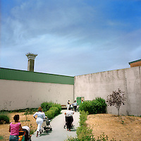 Women going to the kindergarten of Soto del Real prison to pick up their babies before returning to their cells. More than 200 women live with their children in Spanish jails. Children can live with their mothers in prison up to the age of three.