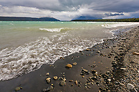 Waves break upon the shore of Naknek lake on a stormy day, Katmai National Park, Alaska.