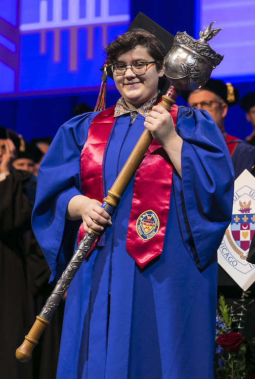Brook Lynn Leonhardt, student speaker, holds the university mace on stage Sunday, June 11, 2017, during the DePaul University College of Science and Health and College of Liberal Arts and Social Sciences commencement ceremony at the Allstate Arena in Rosemont, IL. (DePaul University/Jamie Moncrief)