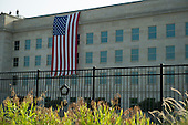 An American flag is seen on the side of the Pentagon during a remembrance of the 12th anniversary of the 9/11 terrorist attacks, on September 11, 2013 in Arlington, Virginia. <br /> Credit: Kevin Dietsch / Pool via CNP