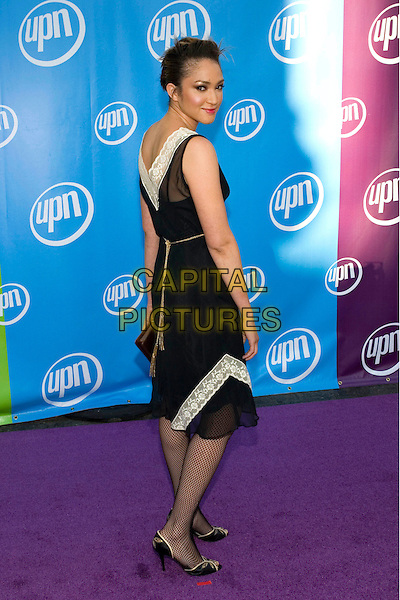 NAIMA MORA.UPN Summer Press Tour Party .Paramount Studios.Los Angeles, 21st July 2005.full length full-length black white lave chiffon dress fishnet tights clutch bag high heels.www.capitalpictures.com.sales@capitalpictures.com.© Capital Pictures.
