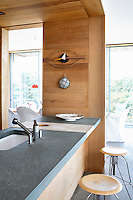 open plan kitchen with wood paneling
