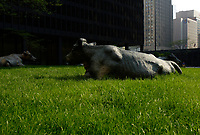 Bull sculpture on the grass beside<br />