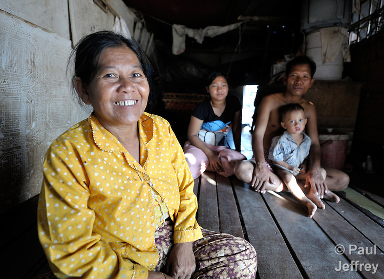 Chet Phan, 52, is one of several women in the Phnom Penh neighborhood of Sen Rikreay who participates in a self-help group. Many people in this community are infected or affected by HIV and AIDS, and Buddhist monks and other religious meet with the women's group regularly to mediate and discuss their challenges.