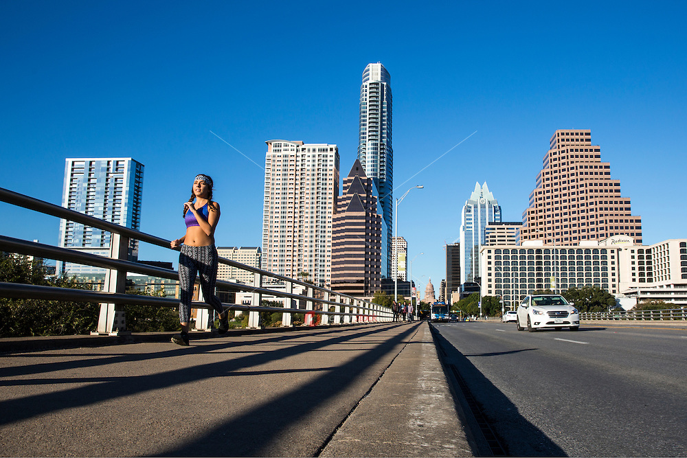 Running in downtown Austin provides an energetic and encouraging feeling in the air that residents and visitors embody full steam in this fit city - Stock Image.