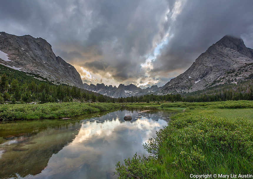 Wind River Range, WY: Storm clouds over the profile of the Cirque of the Towers and Lizard Head with reflections in the North Popo Agie River; Bridger Wilderness in the Bridger National Forest in summer