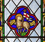 Close up of 19th century stained glass window in church of Saint Andrew, Wissett, Suffolk, England, UK - Lamb of God