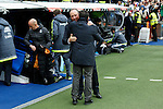 Real Madrid´s coach Rafa Benitez hugs Real Sociedad´s coach Eusebio Sacristan before La Liga match between Real Madrid and Real Sociedad at Santiago Bernabeu stadium in Madrid, Spain. December 30, 2015. (ALTERPHOTOS/Victor Blanco)