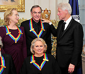 Meryl Streep, left, and Neil Diamond, center, recipients of the 2011 Kennedy Center Honors, share some thoughts with former United States President Bill Clinton after posing for a photo following a dinner hosted by United States Secretary of State Hillary Rodham Clinton at the U.S. Department of State in Washington, D.C. on Saturday, December 3, 2011. Barbara Cook is in the photo at bottom center.  The 2011 honorees are actress Meryl Streep, singer Neil Diamond, actress Barbara Cook, musician Yo-Yo Ma, and musician Sonny Rollins..Credit: Ron Sachs / CNP