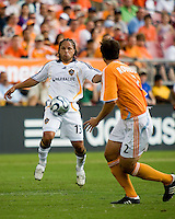LA Galaxy midfielder Cobi Jones (13) attempts to get past Houston Dynamo defender Eddie Robinson (2). The LA Galaxy defeated the Houston Dynamo 2-1  in a regular season MLS match at Robertson Stadium in Houston, TX on October 7, 2007.