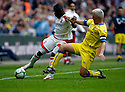 Yemi Odubade of Stevenage Borough is tackled by Paul Jones of Barrow  during the  FA Trophy Final between Barrow and Stevenage Borough at Wembley Stadium, London on 8th May,2010..© Kevin Coleman 2010.