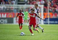 17 September 2011: Toronto FC midfielder Eric Avila #8 and Colorado Rapids midfielder Brian Mullan #11 in action during an MLS game between the Colorado Rapids and the Toronto FC at BMO Field in Toronto, Ontario Canada..Toronto FC won 2-1.