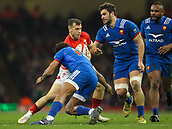 17th March 2018, Principality Stadium, Cardiff, Wales; NatWest Six Nations rugby, Wales versus France; Gareth Davies of Wales evades the attempted tackle by Benjamin Fall of France