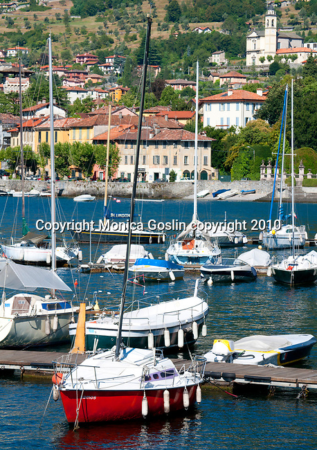 Tremezzo, a town on Lake Como, Italy with colorful boats in the foreground