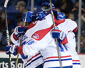 The River Hawks celebrate Michael Budd's (Lowell - 18) game-tying goal. - The visiting Northeastern University Huskies defeated the University of Massachusetts-Lowell River Hawks 3-2 with 14 seconds remaining in overtime on Friday, February 11, 2011, at Tsongas Arena in Lowelll, Massachusetts.