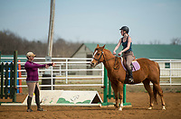 NWA Democrat-Gazette/BEN GOFF @NWABENGOFF<br /> Kendall Holton (right), a volunteer from Bentonville, riding Carlot, takes a sport riding lesson with with Horses for Healing sports riding instructor Krissi Long from Siloam Springs Thursday, March 22, 2018, at Horses for Healing in Bentonville. Horses for Healing is a nonprofit organization that primarily provides therapeutic riding for Northwest Arkansas school children with physical, emotional and mental dissabilities in addition to advanced sport riding lessons and camps for independent riders.