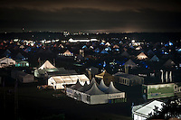 Main Square and parts of Autumn sub camp are nicely lit up in the night. In the distance you can seem some of the higher houses of Kristianstad, the nearest big (albeit smaller) city. Photo: Eric Hampusgård/Scouterna