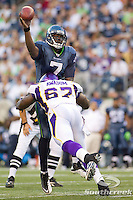 Seattle Seahawks quarterback Tarvaris Jackson (7) attempts to pass the ball while being tackled by Minnesota Vikings defensive end Adrian Awasom (67) at CenturyLink Field in Seattle, Washington. The Minnesota Vikings won the game, 20-7.