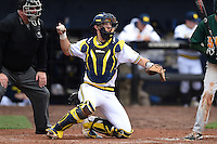 Michigan Wolverines catcher/infielder Drew Lugbauer (17) during the second game of a doubleheader against the Siena Saints on February 27, 2015 at Tradition Field in St. Lucie, Florida.  Michigan defeated Siena 6-0.  (Mike Janes/Four Seam Images)