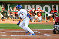 Melvin Santana (9) of the Ogden Raptors at bat against the Idaho Falls Chukars in Pioneer League action at Lindquist Field on July 26, 2014 in Ogden, Utah.  (Stephen Smith/Four Seam Images)