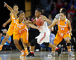 SIOUX FALLS MARCH 25:  Te'a Cooper #20 of Tennessee tries to steal from Kelsey Mitchell #3 of Ohio State during their 2016 NCAA Women's Basketball Sioux Falls Regional Semifinal Friday night at the Denny Sanford Premier Center in Sioux Falls, S.D.  At right is Andrea Carter #14 of Tennessee. (Photo by Dick Carlson/Inertia)