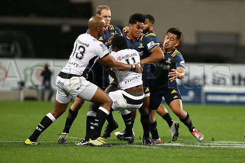 22.04.2016. Dunedin, New Zealand.  Lwazi Mvovo of the Sharks in the tackle of Malakai Fekitoa of the Highlanders in the Super Rugby match between the Highlanders and Sharks, Forsyth Barr Stadium, Dunedin, Friday, April 22, 2016.