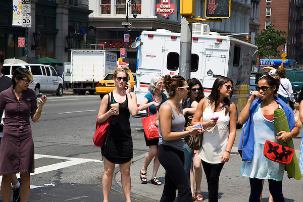"""A woman walks down 6th Avenue in New York City, talking on her cell phone on June 1st 2011.  The World Health Organization (WHO) has listed mobile phone use in the same """"carcinogenic hazard"""" category as lead, engine exhaust, and chloroform, making use of cell phones a possible cancer risk."""