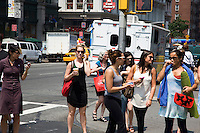 "A woman walks down 6th Avenue in New York City, talking on her cell phone on June 1st 2011.  The World Health Organization (WHO) has listed mobile phone use in the same ""carcinogenic hazard"" category as lead, engine exhaust, and chloroform, making use of cell phones a possible cancer risk."