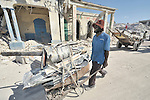 Justin Anelis, 40, scavenges for scrap metal in Port-au-Prince, Haiti, in the wake of a devastating earthquake that shook the Caribbean island nation on January 12.