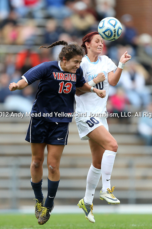 28 October 2012: Virginia's Molly Menchel (13) and UNC's Alyssa Rich (00) challenge for the ball. The University of North Carolina Tar Heels played the University of Virginia Cavaliers at Fetzer Field in Chapel Hill, North Carolina in a 2012 NCAA Division I Women's Soccer game. Virginia defeated UNC 1-0 in their Atlantic Coast Conference quarterfinal match.