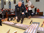 Garda Superintendent Gerry Smith places a candle on the cross at the annual SOSAD mass at the Augustinian church Drogheda. Photo:Colin Bell/pressphotos.ie