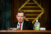 United States Senator John Barrasso (Republican of Wyoming) and chairman of the US Senate Environment and Public Works Committee, places a bottle of hand sanitizer on the dais during a hearing, on Capitol Hill in Washington, D.C., U.S., on Wednesday, May 20, 2020. <br /> Credit: Al Drago / Pool via CNP/AdMedia